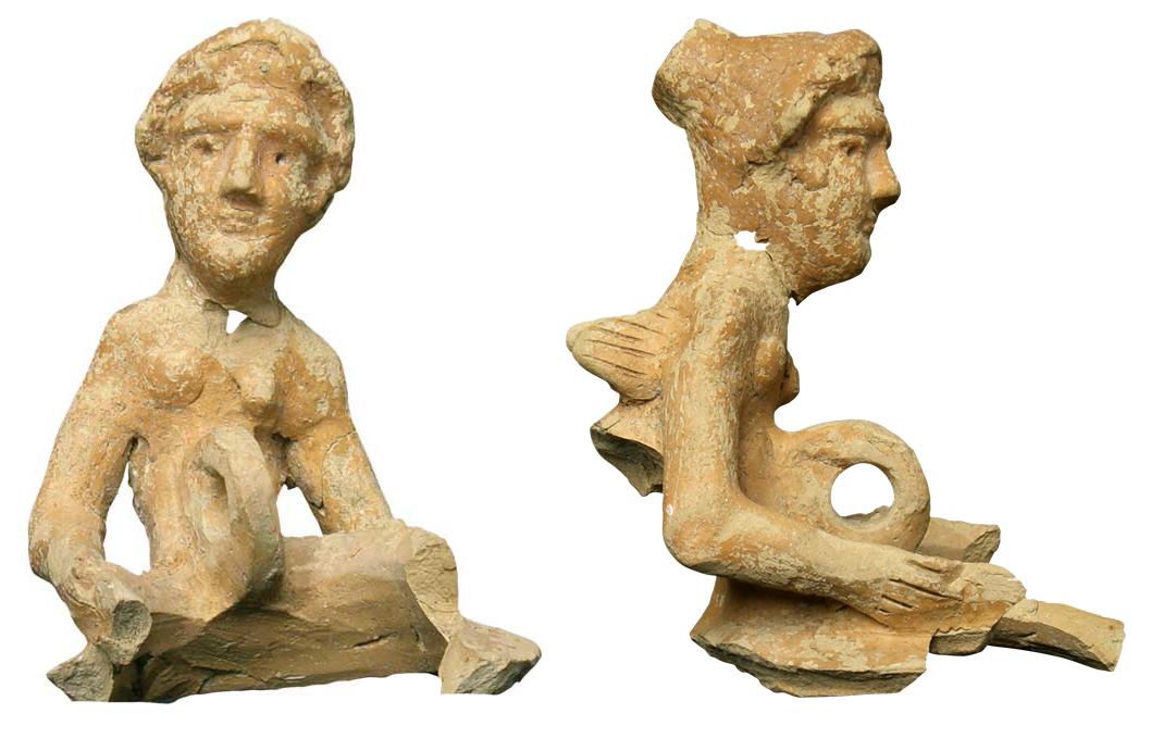 Fragment einer Lampe mit geflügelter Frauenfigur.